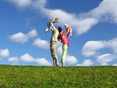 Family with two children under clouds — Stock Photo