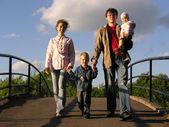 Family on bridge — Stock Photo