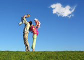 Family with two children and cloud — Stock Photo