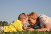 Mother with boy lies on meadow — Stock Photo