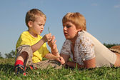 Mother with boy on meadow — Stock Photo