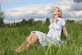 Pregnant girl on meadow — Stock Photo