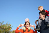 Family with children on shoulders — Stock Photo