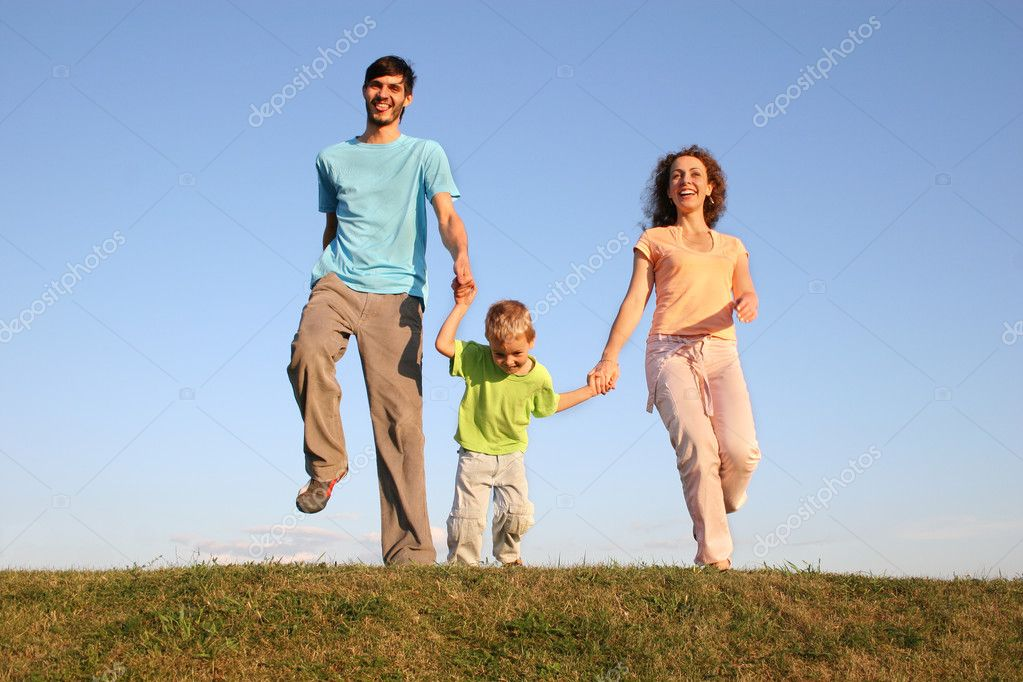 Running family on meadow 2 — Stock Photo #3541251