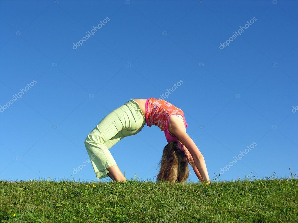 Girl as bridge on grass  Stock Photo #3541428