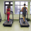Behind girl and boy in health club - Stock Photo