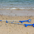 Crutches on beach - Stock Photo