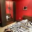 Stock Photo: Stripe red bedroom