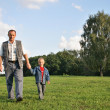 Grandfather and boy walking — Stock Photo
