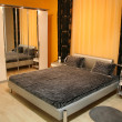 Stock Photo: Bedroom with mirror closet
