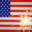 Sparkler on usa flag — Stockfoto #3643331