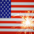Stock Photo: Sparkler on usa flag