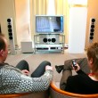 Couple with home theater — Stock Photo