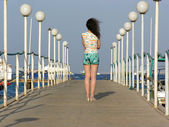 Behind girl on pier — Stock Photo