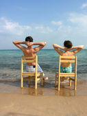 Behind couple on beach — Foto Stock
