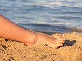 Legs on beach — Stock Photo