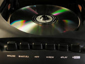 Compact disk in player — Stock Photo