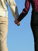 Man & woman holding hands — Stock Photo
