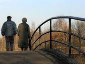Retirees on bridge — Stock Photo