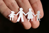 Paper family on hand — Stock Photo