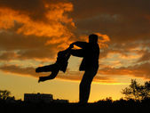 Father rotate son sunset — Stock Photo