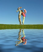 Family of four and lake — Stock Photo