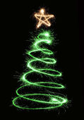 Green sparkler christmas tree spiral — Stock Photo