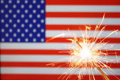 Sparkler on usa flag — Stock Photo