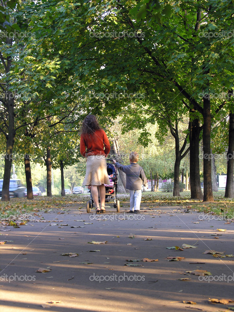 Mother with son and baby walk on autumn lad — Stock Photo #3642344