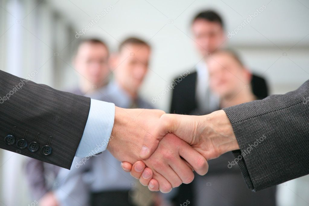 Shaking hands and business team  Stock Photo #3643888