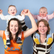 Babies on mothers shoulders — Stock Photo
