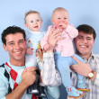 Babies on fathers shoulders — Stock Photo