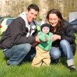 Spring family with baby in yard — Stock Photo