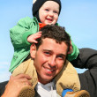 Stock Photo: Baby on father's shoulders