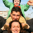 Family with baby on shoulders — Stock Photo