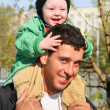 Stock Photo: Baby on father's shoulders 2