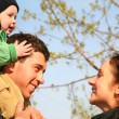 Family with baby on shoulders 2 — Stock Photo