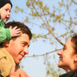 Family with baby on shoulders 2 — Stock Photo #3684932