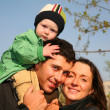 Family with baby on shoulders 3 — Stock Photo