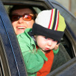 Stock Photo: Mother with baby in car