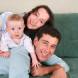 Family with baby on sofa 3 — Stock Photo