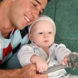 Father with baby with extension wrench - Stock Photo
