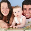 Royalty-Free Stock Photo: Family with baby read book
