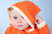 Baby with biggin — Stock Photo