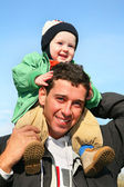 Baby on father's shoulders — Stock Photo