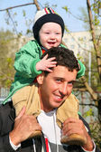 Baby on father's shoulders 2 — Stock Photo