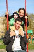 Family on seesaw 2 — Stock Photo