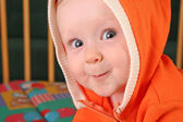 Smile baby boy with hood — Stock Photo