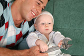 Father with baby with extension wrench — Stock Photo