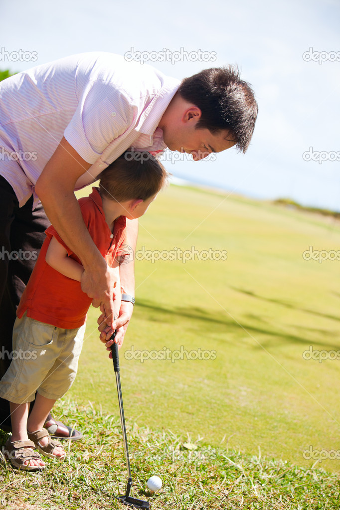 Father teaching his son to play golf — Stock Photo #3587027